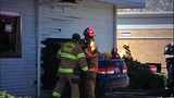 Car takes wild ride through side of building - (3/9)