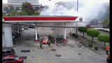 Car catches fire after crash into gas pump - (13/13)