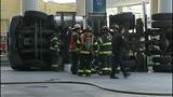 Semi flips, leaks diesel in crash - (3/9)