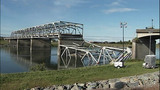 Daylight shows full extent of bridge damage - (4/15)