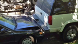Speeding SUV crashes into parked cars - photos - (4/8)