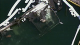 PHOTOS: Burned-out yacht sinks in Roche Harbor - (2/10)