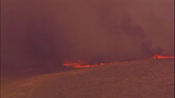 PHOTOS: Thousands of acres burn in… - (3/15)