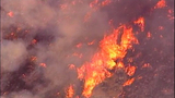 PHOTOS: Thousands of acres burn in… - (12/15)