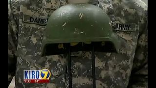 JBLM soldier reunited with helmet that saved his life - KIRO