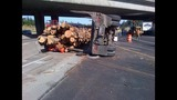 PHOTOS: Logging truck tips over on I-405 near… - (1/10)