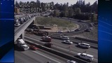 PHOTOS: Logging truck tips over on I-405 near… - (2/10)