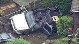 PHOTOS: Woman, grandson OK after wild crash - (5/9)