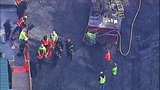 PHOTOS: Workers rescued from construction site trench - (3/11)