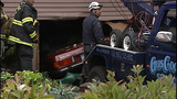 PHOTOS: Car ends up in home's basement - (12/15)
