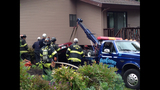 PHOTOS: Car ends up in home's basement - (10/15)