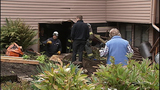 PHOTOS: Car ends up in home's basement - (3/15)
