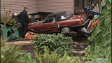 PHOTOS: Car ends up in home's basement - (13/15)