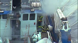 PHOTOS: Smoke pours from burning boat - (6/14)