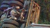 PHOTOS: Runaway dump truck hits van, overturns - (13/15)