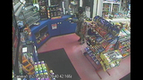 PHOTOS: Armed, masked man robs gas station - (3/4)