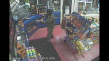 PHOTOS: Armed, masked man robs gas station - (4/4)