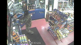 PHOTOS: Armed, masked man robs gas station - (1/4)