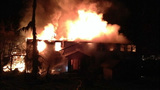 PHOTOS: Fire devours home, killing doctor, child - (7/13)