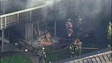 PHOTOS: Fire tears through apartments, killing 1 - (10/12)