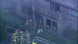 PHOTOS: Fire tears through apartments, killing 1 - (8/12)