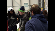 Richard Sherman (left) and Russell Wilson (right) with Bubba (middle).