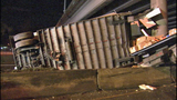 PHOTOS: Packages litter road after semi rolls over - (1/18)