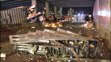 PHOTOS: Packages litter road after semi rolls over - (11/18)