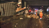 PHOTOS: Packages litter road after semi rolls over - (12/18)