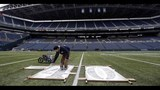 PHOTOS: Workers ready field for Seahawks game… - (9/11)