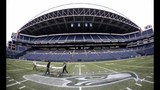 PHOTOS: Workers ready field for Seahawks game… - (1/11)