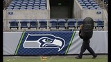 PHOTOS: Workers ready field for Seahawks game… - (8/11)