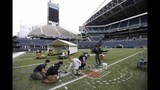 PHOTOS: Workers ready field for Seahawks game… - (3/11)