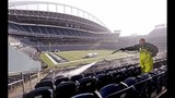 PHOTOS: Workers ready field for Seahawks game… - (6/11)
