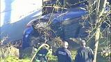 PHOTOS: Car slams into building, rolls over - (10/11)