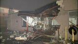 PHOTOS: Bus punches through Burien building - (5/21)