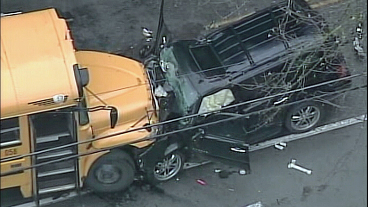 PHOTOS SUV smashed in crash with school bus  KIROTV