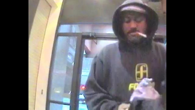 Police say this man robbed a blind man at an ATM in downtown Seattle March 1.