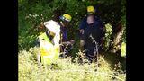 PHOTOS: Crews rescue dog over cliff - (2/13)
