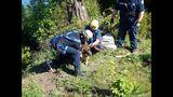 PHOTOS: Crews rescue dog over cliff - (13/13)