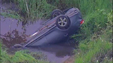 PHOTOS: Car flies off road into Auburn creek - (5/9)