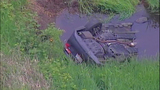 PHOTOS: Car flies off road into Auburn creek - (6/9)