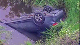 PHOTOS: Car flies off road into Auburn creek - (4/9)