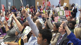 $15 minimum wage supporters at City Council meeting_5325167