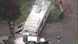 PHOTOS: Man crashes stolen RV into 2 homes, 5 cars - (5/14)