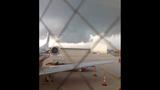 PHOTOS: Morgan Palmer on plane damaged by… - (2/3)