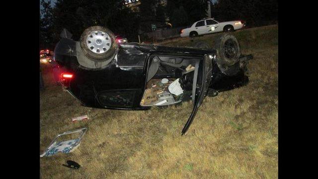 Troopers are investigating after finding a man naked and unconscious in a rollover crash on Interstate 5 and Northgate Way.