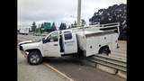 PHOTOS: Truck lands on guardrail, crosses freeway - (7/7)