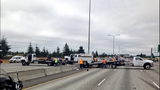 PHOTOS: Truck lands on guardrail, crosses freeway - (4/7)