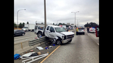 PHOTOS: Truck lands on guardrail, crosses freeway - (1/7)